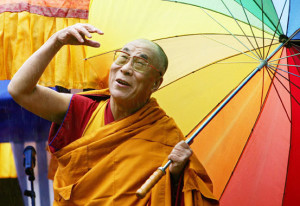 PICTURES OF THE YEAR 2006 Tibetan spiritual leader, the Dalai Lama, waves to the crowd during the inauguration of the Thupten Shedrub Ling temple on the outskirts of Huy, Belgium, May 29, 2006.    REUTERS/Thierry Roge BELGIUM DALAI LAMA