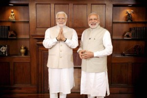New Delhi: Prime Minster Narendra Modi stands next to his wax statue due to be placed at London's Madame Tussauds museum, in New Delhi. Three of his wax statues have been installed in Singapore, Hong Kong and Bangkok and one of them will be put up in London in the next eight days. PTI Photo / Madame Tussauds museum(PTI4_20_2016_000175A)